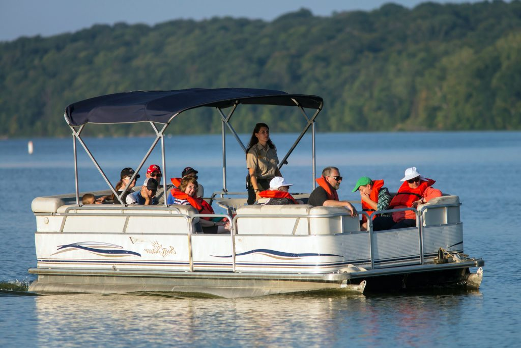 family on a pontoon boat in the water