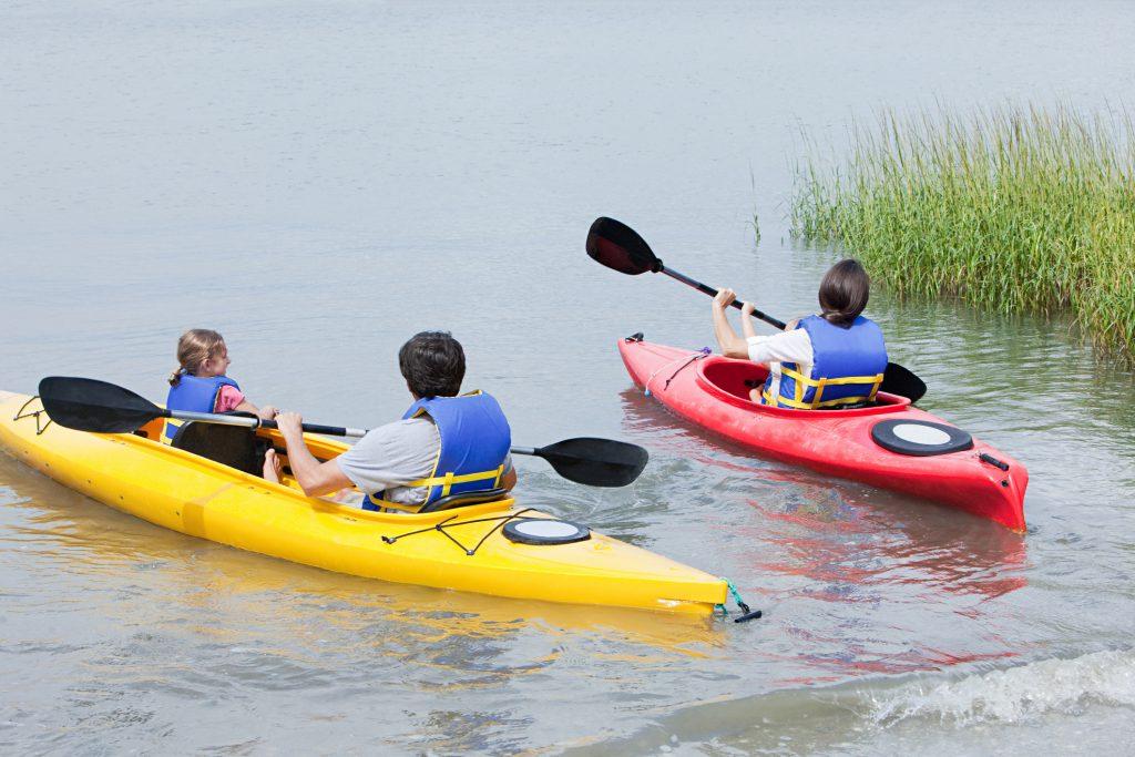 water, kayak, father and daughter in yellow kayak, mom in red kayak,
